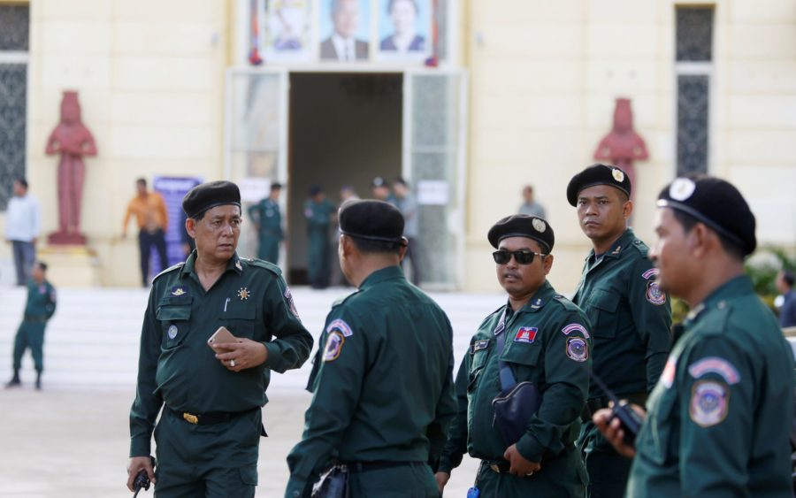 Police officers stand guard at the Supreme Court in Phnom Penh, Cambodia, November 16, 2017.