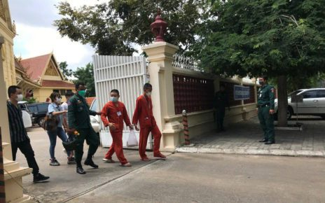 Prum Suos Samang, right, walks out of the Supreme Court after his hearing on October 20, 2021. (Ouch Sony/VOD)